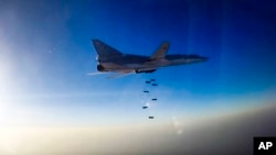 In this frame grab provided by the Russian Defense Ministry press service, a Tu-22M3 long-range bomber flies during an airstrike over the Aleppo region of Syria, Aug. 16, 2016.