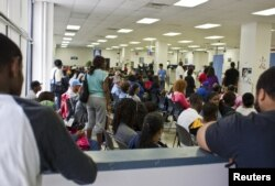 FILE - People fill the waiting area of a Pennsylvania Department of Transportation office in Philadelphia as they wait to get a voter ID card, Sept. 27, 2012.