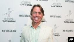 FILE - Taste America All-Star John Besh attends the kick-off event for the James Beard Foundation's Taste America® 10-city national tour, held Wednesday, August 3, 2016 at the James Beard House in New York City.