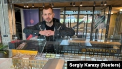 Promprylad project founder Yuriy Fylyuk next to a model of the project on May 29, 2021. Entrepreneursin western Ukraine are turning a large manufacturing building fromSoviet times into a center for education, business, and art.(REUTERS/Sergiy Karazy)