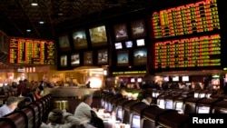 Proposition bets (R) for Super Bowl XLV are posted at the race and sports book in the Las Vegas Hilton in Las Vegas, Nevada, Jan. 27, 2011