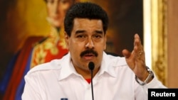 Venezuela's President Nicolas Maduro speaks during a meeting with mayors and governors at Miraflores Palace in Caracas, Jan. 8, 2014.