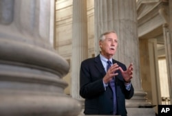 FILE - Senate Intelligence Committee member Angus King, I-Maine, speaks on Capitol Hill in Washington, Dec. 9, 2014.
