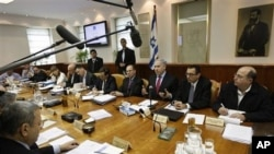 Israel's Prime Minister Benjamin Netanyahu, center, convenes the weekly cabinet meeting in Jerusalem, March 13, 2011