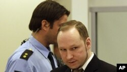 Accused Norwegian Anders Behring Breivik arrives at the courtroom, in Oslo, Norway, April 17, 2012.