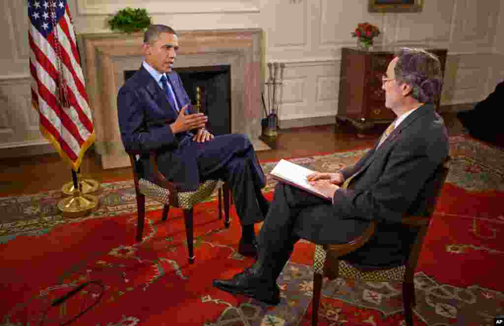 June 22: President Barack Obama during an interview about Afghanistan, with Voice of America's Andre DeNesnera in the Map Room of the White House. (Official White House Photo by Lawrence Jackson)