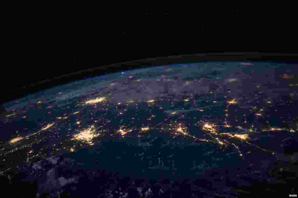 One of the Expedition 40 crew members aboard the International Space Station photographs this nighttime image showing city lights in at least half a dozen southern states from some 225 miles above the home planet. Lights from areas in the Gulf Coast states of Texas, Louisiana, Mississippi and Alabama, as well as some of the states that border them on the north, are visible.