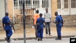 Police arrest a man following grenade attacks in Bujumbura, Burundi, Feb. 3, 2016. Abuses in the country reportedly continue despite a pledge by President Pierre Nkurunziza to work toward national unity.