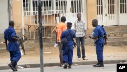 FILE- Police arrest a man following grenade attacks in the capital Bujumbura, Burundi Wednesday, Feb. 3, 2016.