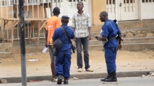 FILE - Police arrest a man following grenade attacks in the capital Bujumbura, Burundi Wednesday, Feb. 3, 2016.