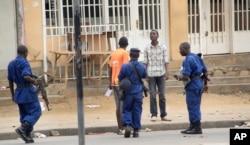 Police arrest a man following grenade attacks in the capital Bujumbura, Burundi Wednesday, Feb. 3, 2016.
