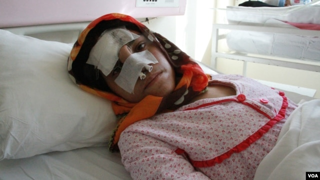 FILE - Reza Gul was hospitalized after being attacked by her husband.