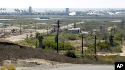 FILE - This Aug. 18, 2016 file photo shows Banning Ranch, including what remains of an oil-extraction operation, on what is believed to be the biggest piece of privately owned vacant land on Southern California's coast in Newport Beach.
