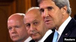 U.S. Secretary of State John Kerry (R), British Foreign Secretary William Hague (L) and French Foreign Minister Laurent Fabius attend a news conference after a meeting on Syria conflict at the Quai d'Orsay ministry in Paris Sept. 16, 2013.