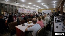 FILE - The Syrian Democratic Council meets in Tabqa, Syria, July 16, 2018.