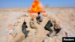 Šiitski borci koji su se priključili iračkoj vojsci u borbi protiv Islamske države, tokom obuke u pokrajini Nadžaf