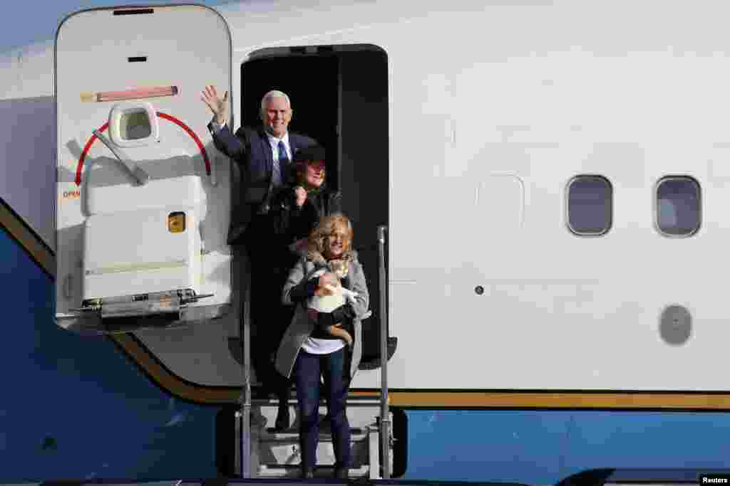 Vice President-elect Mike Pence, his wife Karen and daughter Charlotte (bottom) arrive on Air Force Two at Joint Base Andrews, Maryland, Jan. 9, 2017.