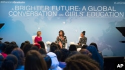 "First lady Michelle Obama, flanked by actress Yara Shahidi (R) and Glamour Magazine Editor in Chief Cindi Leive, participates in Glamour's ""A Brighter Future: A Global Conversation on Girls' Education,"" in celebration of International Day of the Girl and Let Girls Learn, Oct. 11, 2016, at the Newseum in Washington."