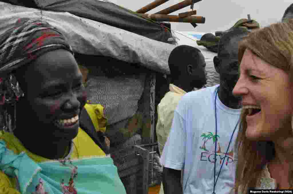 UNMISS head Hilde Johnson (R) shares a laugh with a South Sudanese woman, inside the UNMISS base in Malakal where around 19,000 people are sheltering.