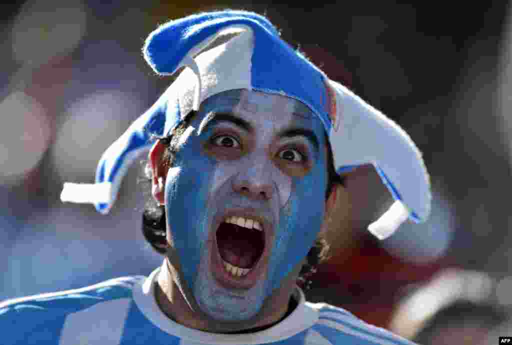 An Argentina fan cheers prior to a Round of 16 football match between Argentina and Switzerland at Corinthians Arena in Sao Paulo, Brazil, during the 2014 FIFA World Cup.