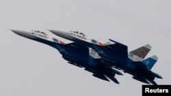 FILE - Russian air force Su-27 jet fighters perform at an air show outside Moscow in 2011.