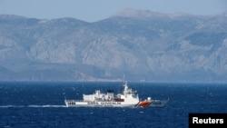 FILE -A Turkish coast guard ship patrols in the Aegean Sea, off the Turkish coast, April 20, 2016.