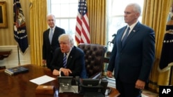 President Donald Trump, flanked by Health and Human Services Secretary Tom Price, left, and Vice President Mike Pence, meets with reporters regarding the health care overhaul bill at the White House in Washington, March 24, 2017.