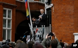 Wikileaks founder Julian Assange speaks on the balcony of the Ecuadorean Embassy in London, Feb. 5, 2016.