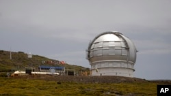 FILE - The Gran Telescopio Canarias, one of the the world's largest telescopes, is viewed at the Observatorio del Roque de los Muchachos on the Canary Island of La Palma, Spain. The designation of the Canary Islands as an alternative site for the TMT comes nearly a year after the Hawaii Supreme Court blocked construction of the telescope on the Big Island.