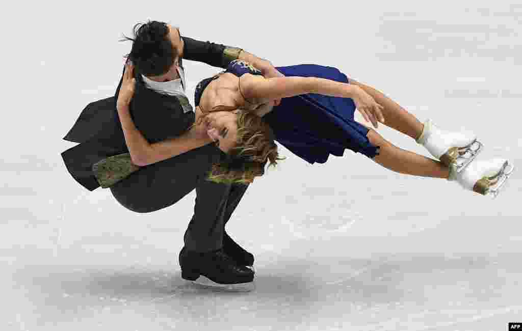 Gabriela Papadakis and Guillame Cizeron of France compete during short ice dance program during the European Figure Skating Championship in Ostrava, Czech Republic.