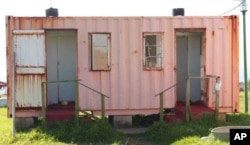 The rusty, dilapidated building that serves as a toilet for TB patients at a rural hospital in South Africa