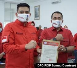 Bakal calon Wali Kota Medan, Bobby Afif Nasution dan wakilnya Aulia Rahman yang diusung PDIP dalam kontestasi Pilkada Medan 2020, Selasa, 11 Agustus 2020. (Foto: Courtesy/DPD PDIP Sumut)