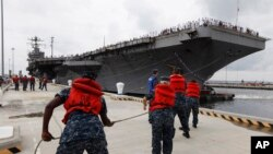 "FILE - Navy crews haul in lines as the USS Abraham Lincoln arrives at Naval Station Norfolk in Norfolk, Virgina, Aug. 7, 2012. The U.S. has dispatched the aircraft carrier to the Middle East following ""clear indications"" that Iran was preparing to possibly attack U.S. forces."