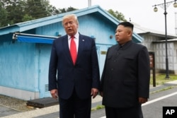 FILE - President Donald Trump meets with North Korean leader Kim Jong Un at the border village of Panmunjom in the Demilitarized Zone, South Korea, June 30, 2019.