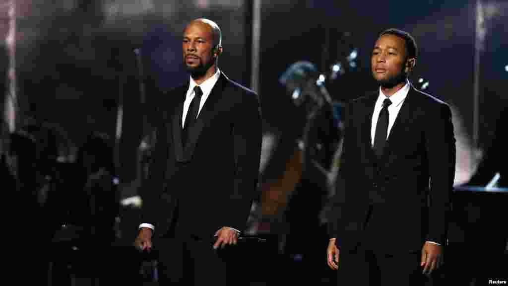 "Common, left, and John Legend stand after performing ""Glory"" from the film ""Selma"" at the 57th annual Grammy Awards in Los Angeles, California, Feb. 8, 2015."