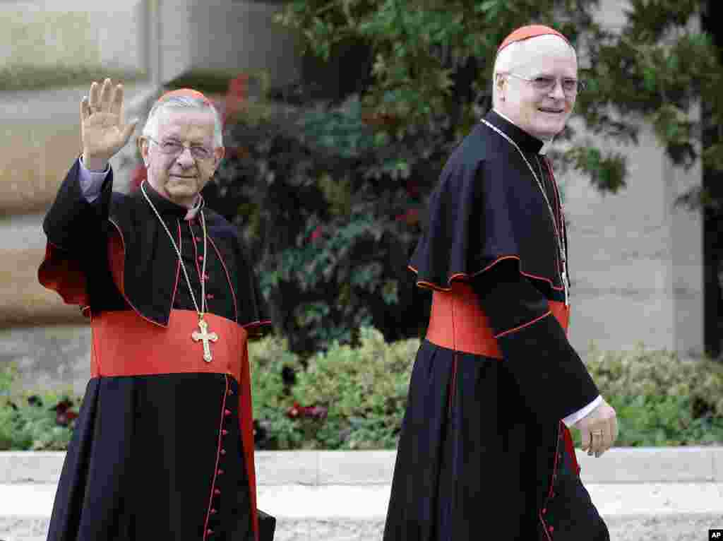 Cardinal Odilo Pedro Scherer, of Brazil, right, is followed by Cardinal Geraldo Majella Agnelo as they arrive for a meeting at the Vatican, March 8, 2013.