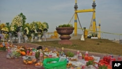 Cambodians have left traditional offerings at the foot of the Diamond bridge, the site of Phnom Penh's worst Water Festival stampede that took place on Monday November 22, 2010.