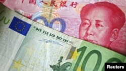 A 100 Euro banknote is placed on top of a 100 yuan banknote in this illustration taken in Beijing, November 7, 2010.