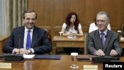 Grčki premijer Antonis Samaras (L) i ministar finansija u ostavci Vasilis Rapanos