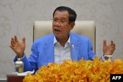 Cambodia's Prime Minister Hun Sen speaks to the media during a press conference at the Peace Palace in Phnom Penh on April 7, 2020. (Photo by TANG CHHIN Sothy/AFP)