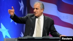 FILE - Zalmay Khalilzad, former U.S. ambassador to Afghanistan, Iraq and the United Nations, leads a panel discussion on Afghanistan at the Conservative Political Action conference (CPAC) in Washington, Feb. 12, 2011.