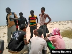 FILE - U.N. Migration Agency staff assist Somali and Ethiopian migrants who were forced into the sea by smugglers.