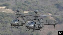 """美國陸軍的""""基奧瓦勇士""""直升機在朝鮮半島參加美韓聯合實彈演習。(資料圖片)"""