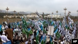 Supporters of religious parties rally against government allowing NATO to resume shipping supplies through the country to its troops in neighboring Afghanistan, near the Parliament in Islamabad, Pakistan, March 27, 2011.