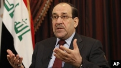 Iraq's Prime Minister Nouri al-Maliki speaks during an interview with The Associated Press in Baghdad, Iraq, December 3, 2011.