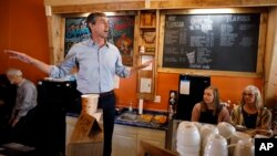 FILE - Democratic presidential candidate Beto O'Rourke speaks to local residents during a stop at the Central Park Coffee Company in Mount Pleasant, Iowa, March 15, 2019.