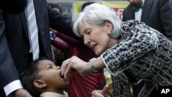 U.S. Health and Human Services Secretary Kathleen Sebelius administers polio vaccine to a child in New Delhi, India, January 13, 2012.