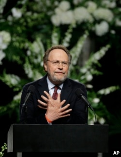 Comedian Billy Crystal delivers a eulogy during Muhammad Ali's memorial service in Louisville, Ky., June 10, 2016.