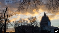 The sun rises over the U.S. Capitol in Washington, Jan. 5, 2015, as the 114th Congress prepares to open Tuesday. (AP Photo/J. Scott Applewhite)