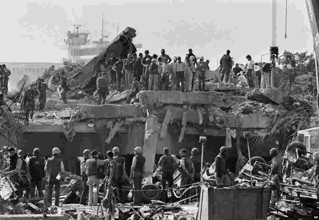 FILE - Rescuers continue to probe the wreckage of the U.S. Marine barracks after a suicide truck bomb near Beirut airport, Lebanon, Oct. 23, 1983.